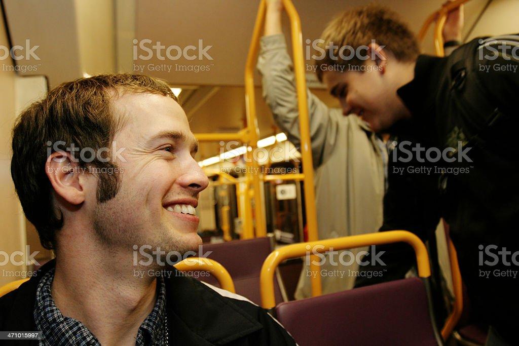 Friends Riding on Public Transportation royalty-free stock photo