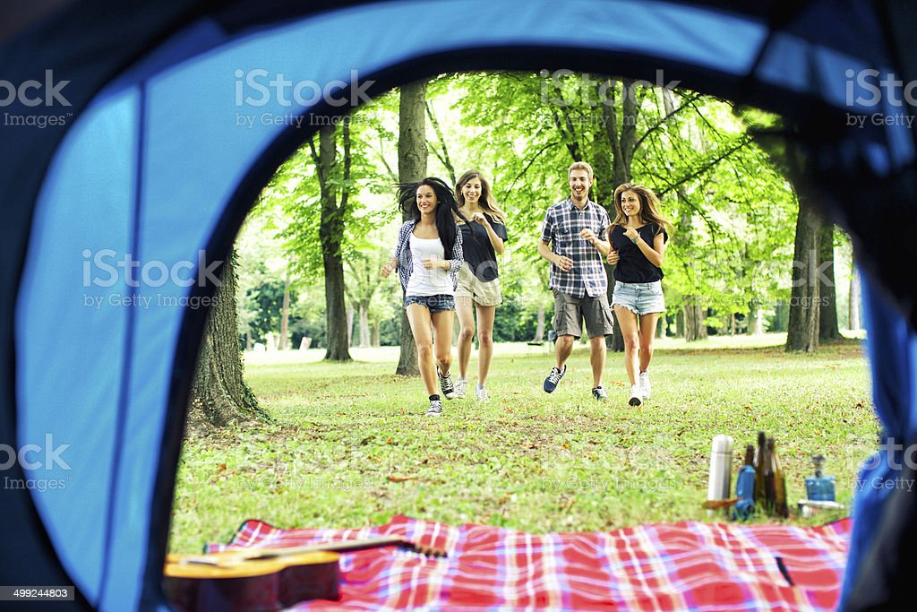 Friends run to the tent stock photo