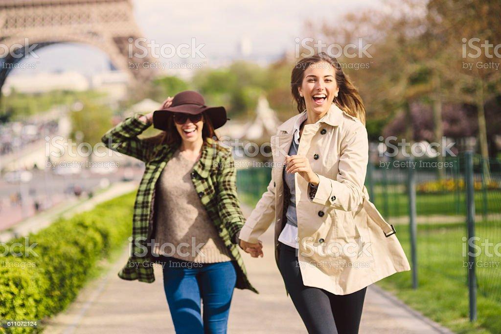 Friends running in Paris stock photo
