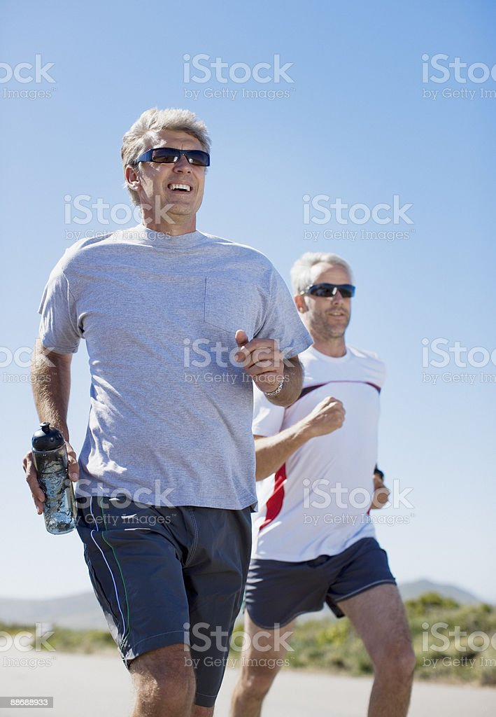 Friends running on beach royalty-free stock photo