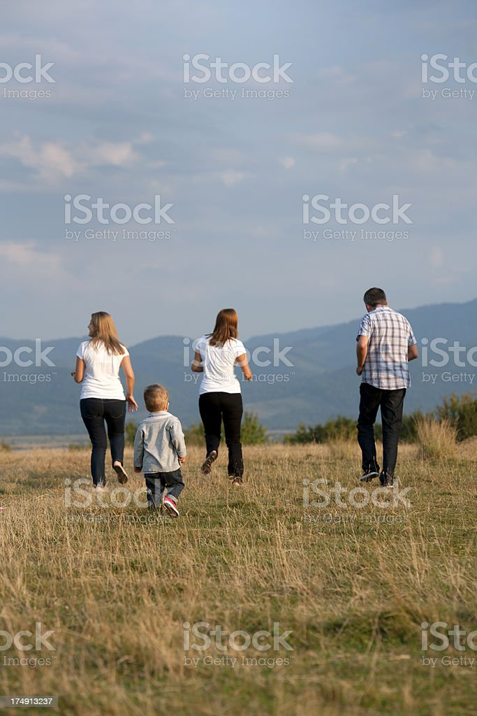 friends running on field royalty-free stock photo