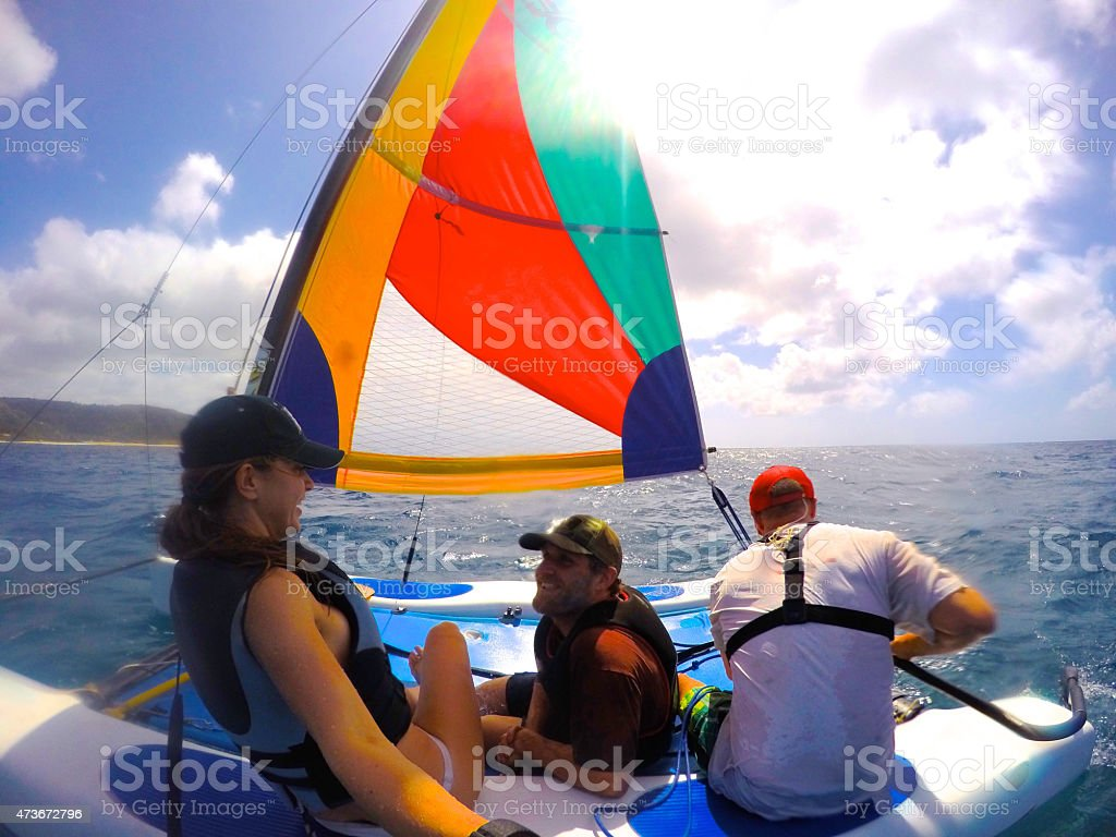 Friends Sailing a Hobie Cat stock photo