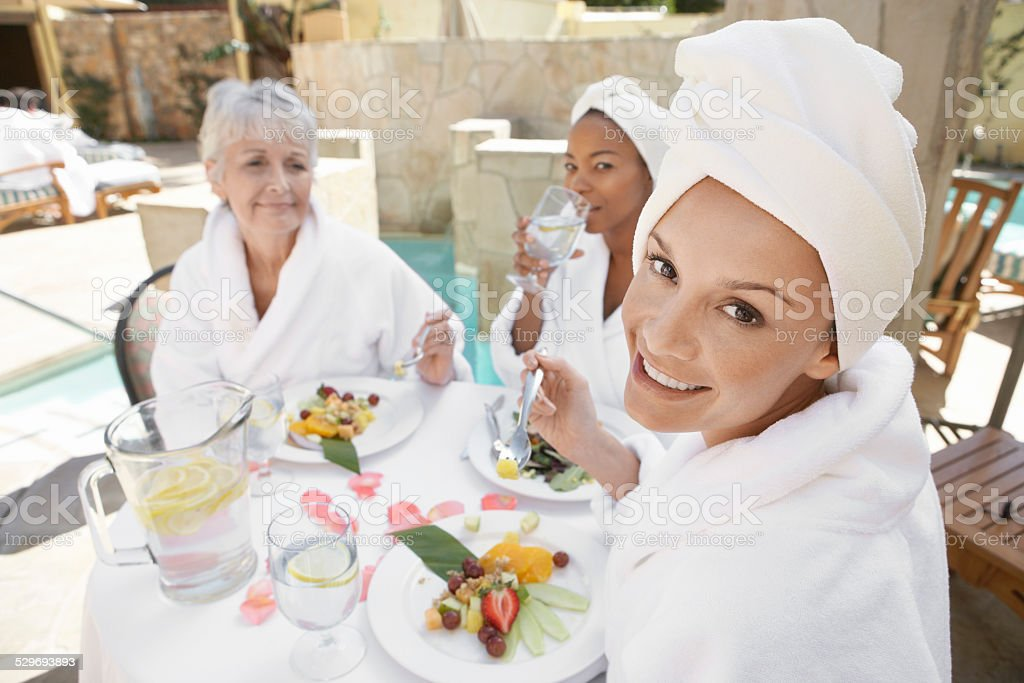 Friends Sharing a Fresh Meal at the Spa stock photo