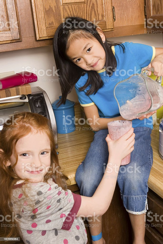 Friends sharing a healthy smoothie royalty-free stock photo