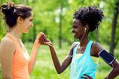 Friends sharing music befor morning jogging