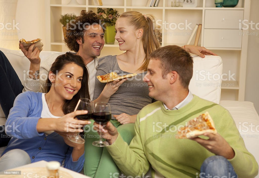 Friends Sharing Pizza royalty-free stock photo