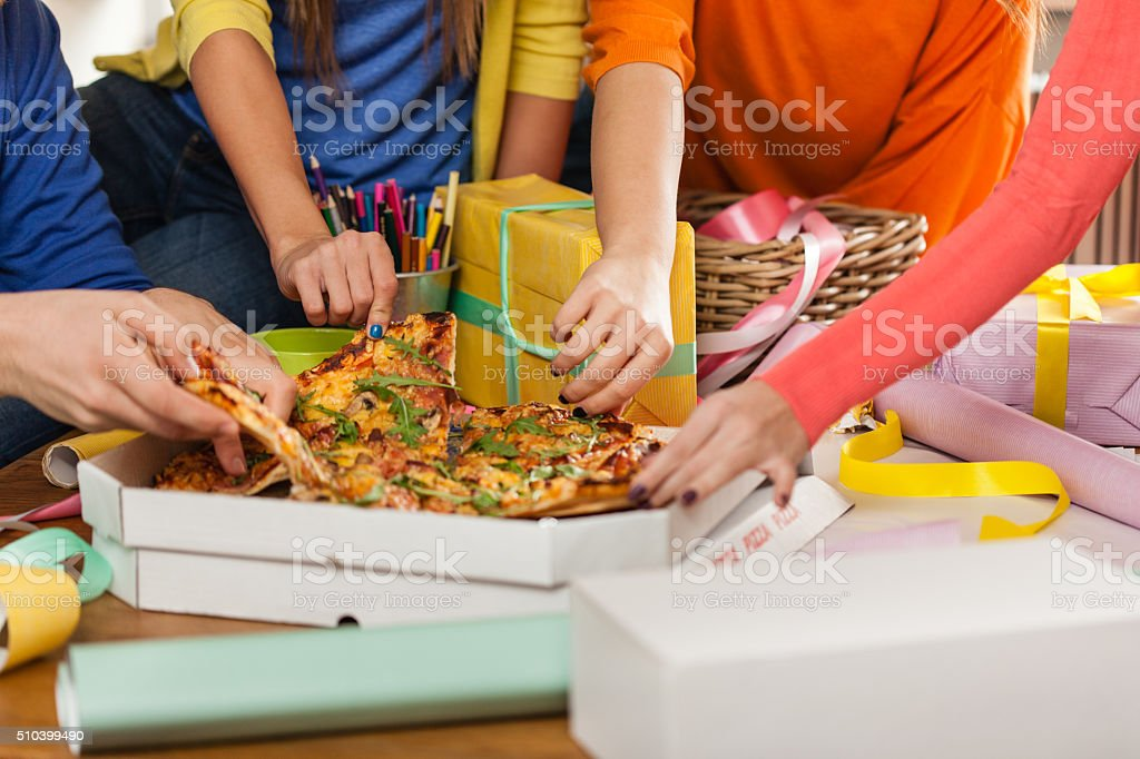 Friends sharing pizza stock photo