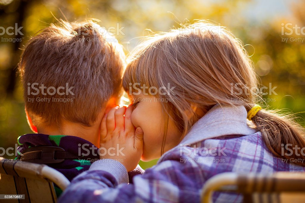 Friends sharing secrets stock photo