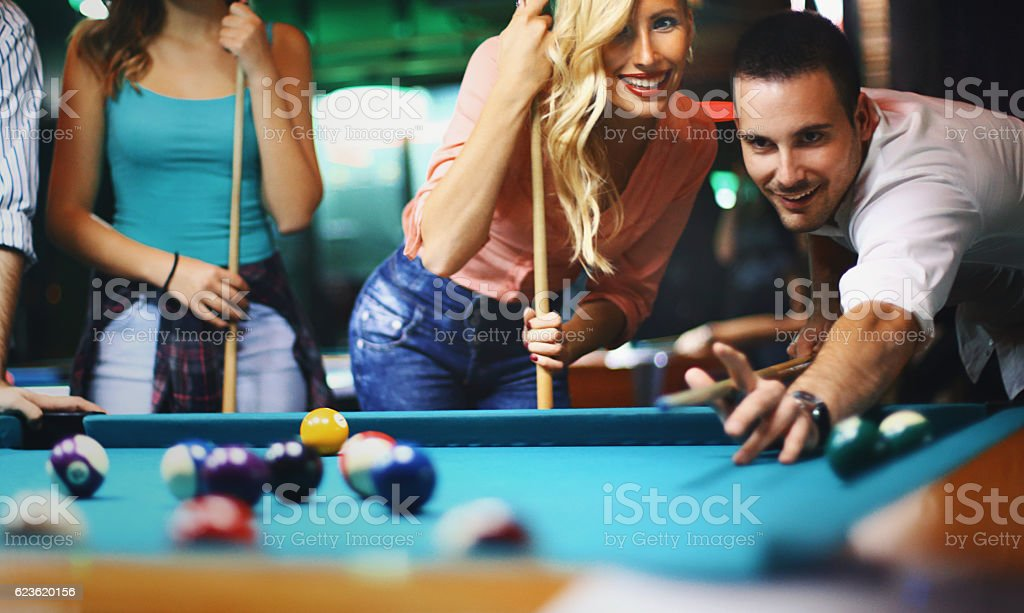 Friends shooting pool. stock photo