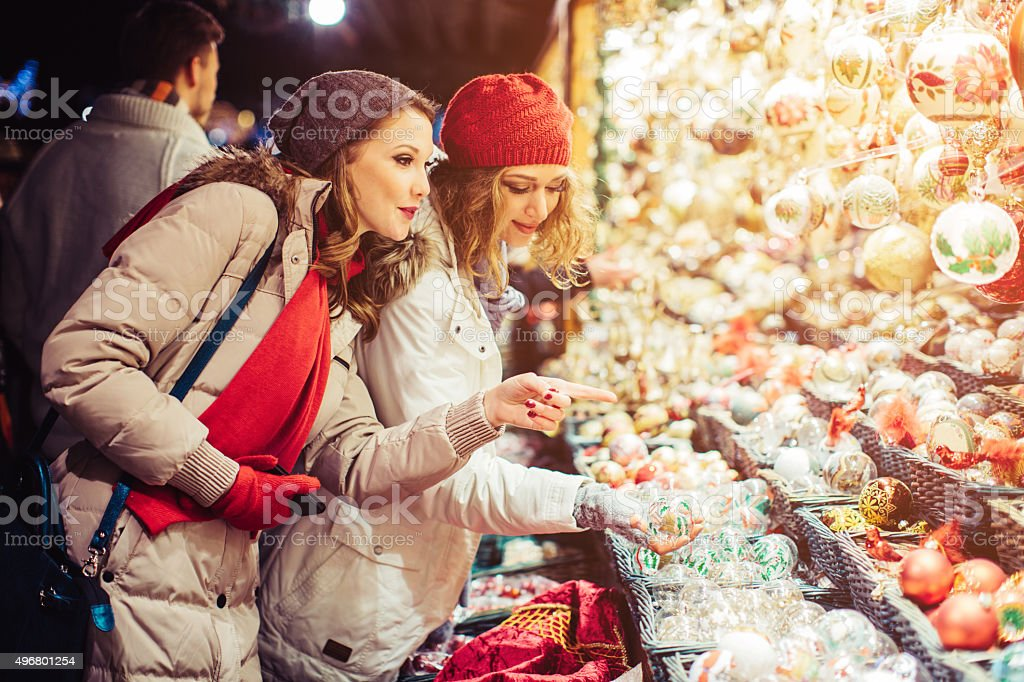 Friends shopping at christmas fair. stock photo