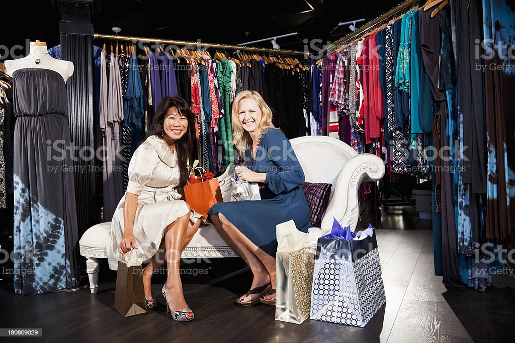 Friends shopping for clothes stock photo