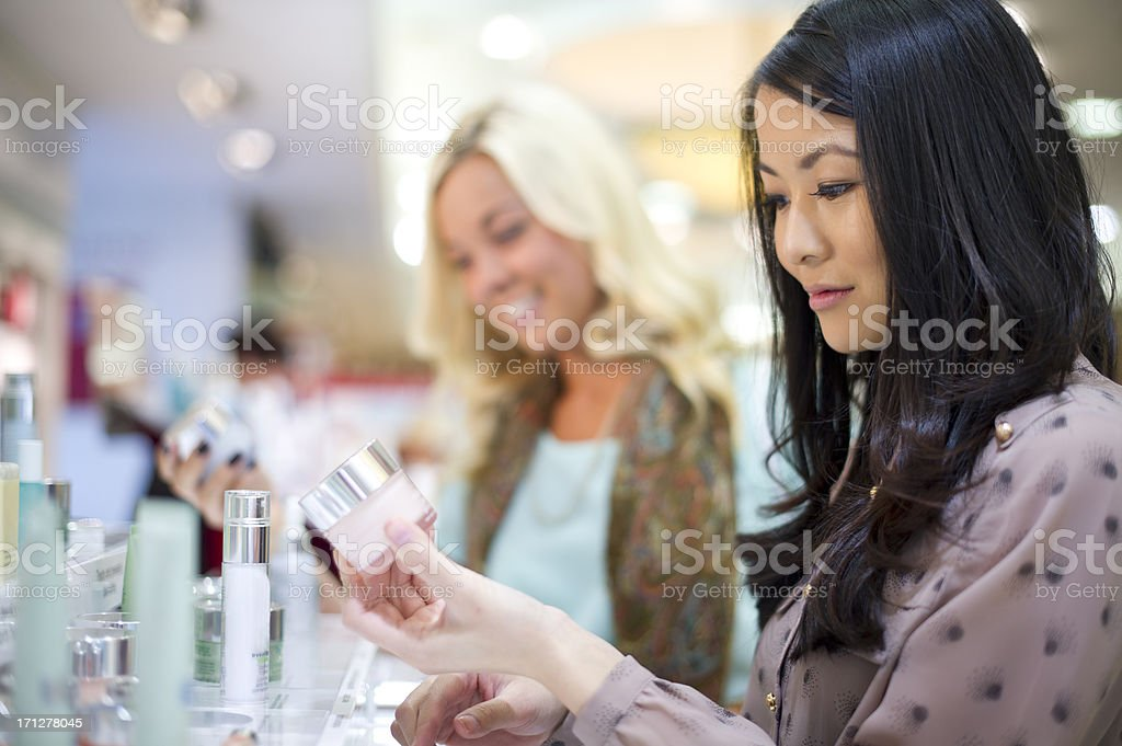 friends shopping for cream stock photo