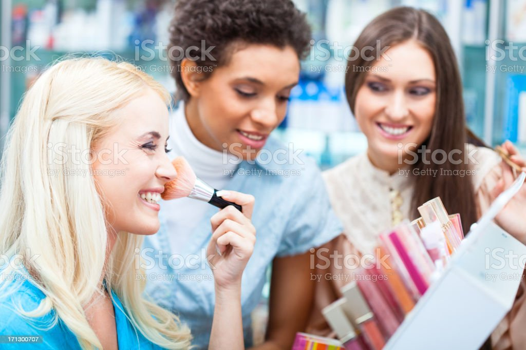 Friends shopping for make-up royalty-free stock photo