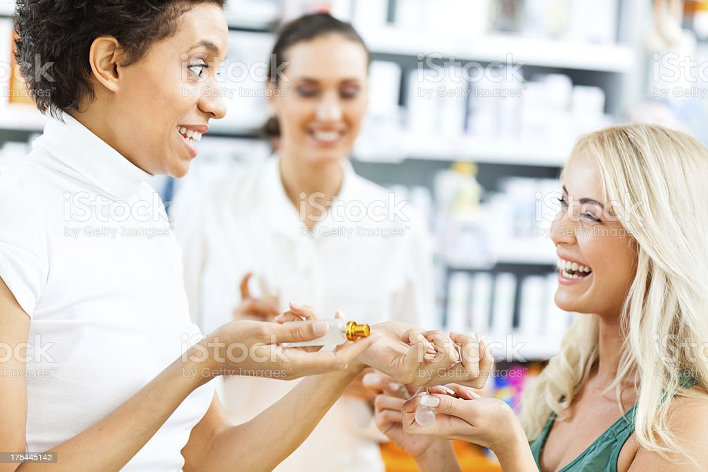 Friends shopping for parfume stock photo