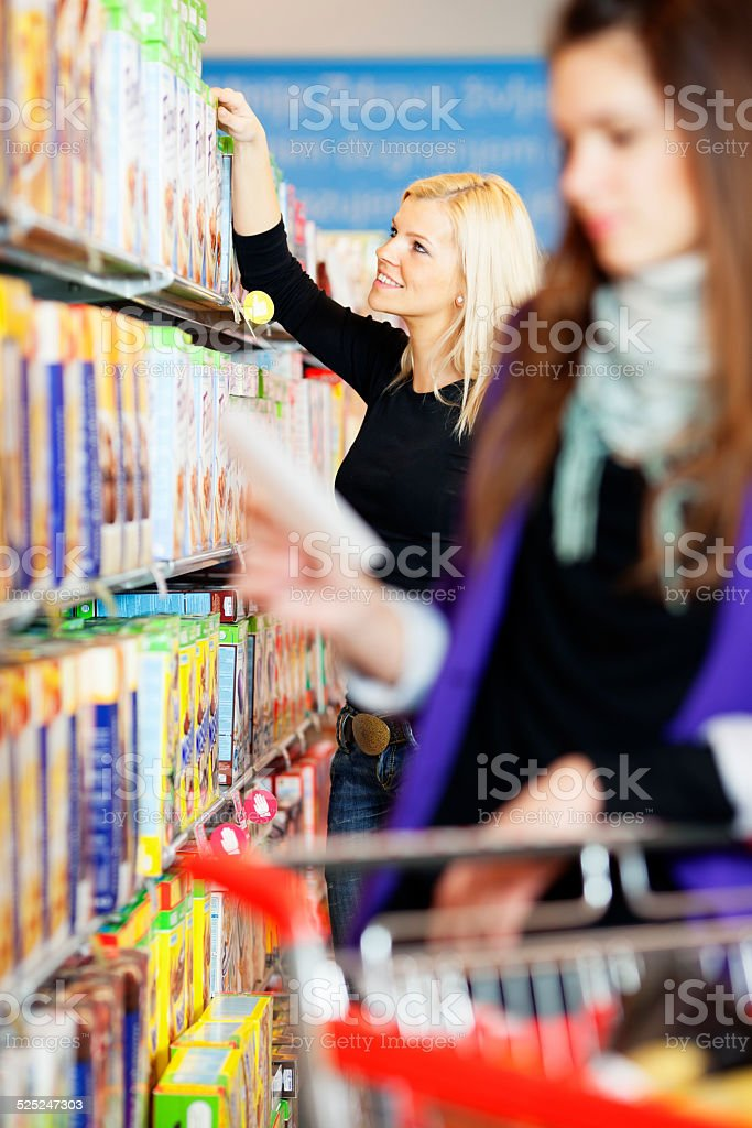 friends  shopping in grocery store stock photo