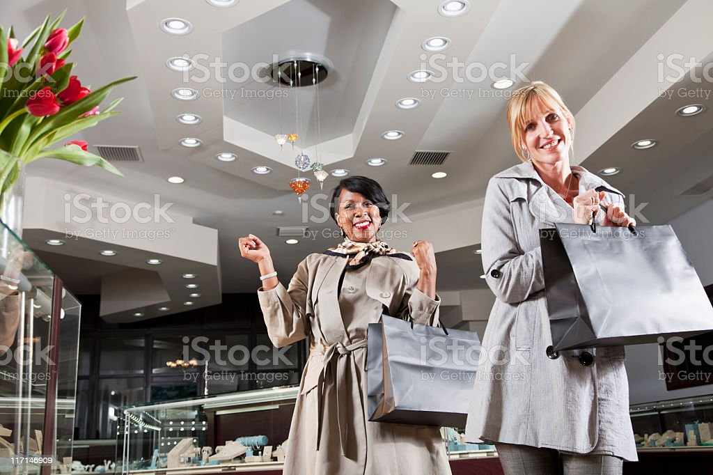 Friends shopping together in jewelry store royalty-free stock photo
