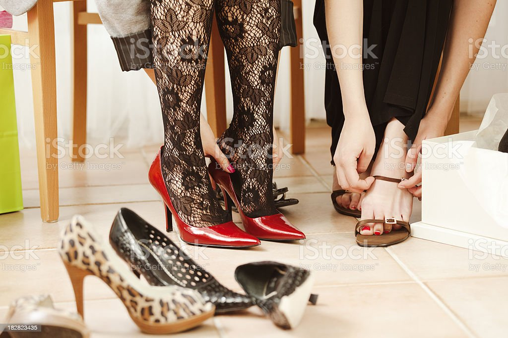 Friends Shopping Together in Retail Shoes Boutique Hz royalty-free stock photo
