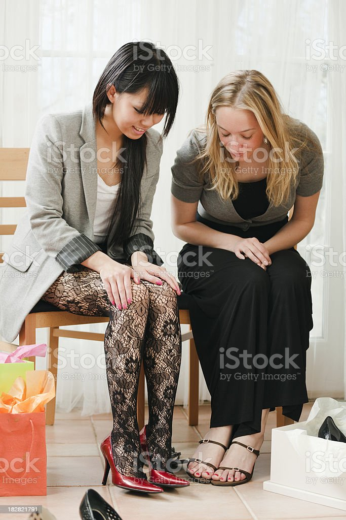 Friends Shopping Together in Retail Shoes Store Vt royalty-free stock photo