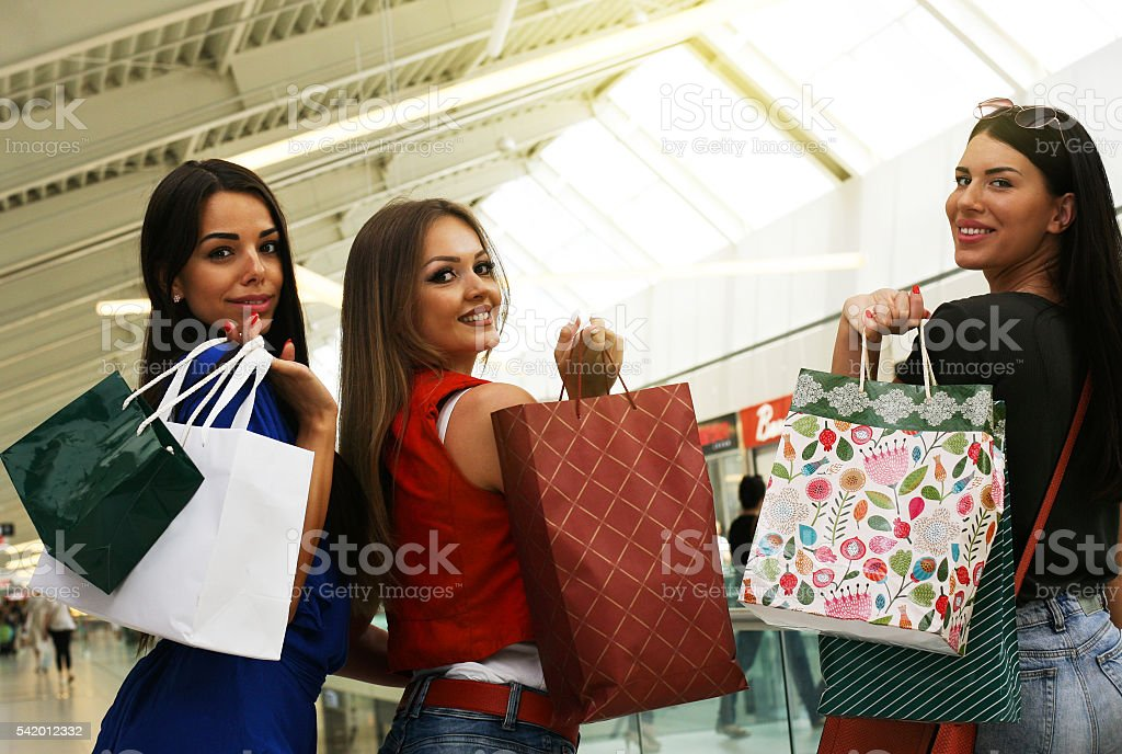 Friends shopping together. stock photo