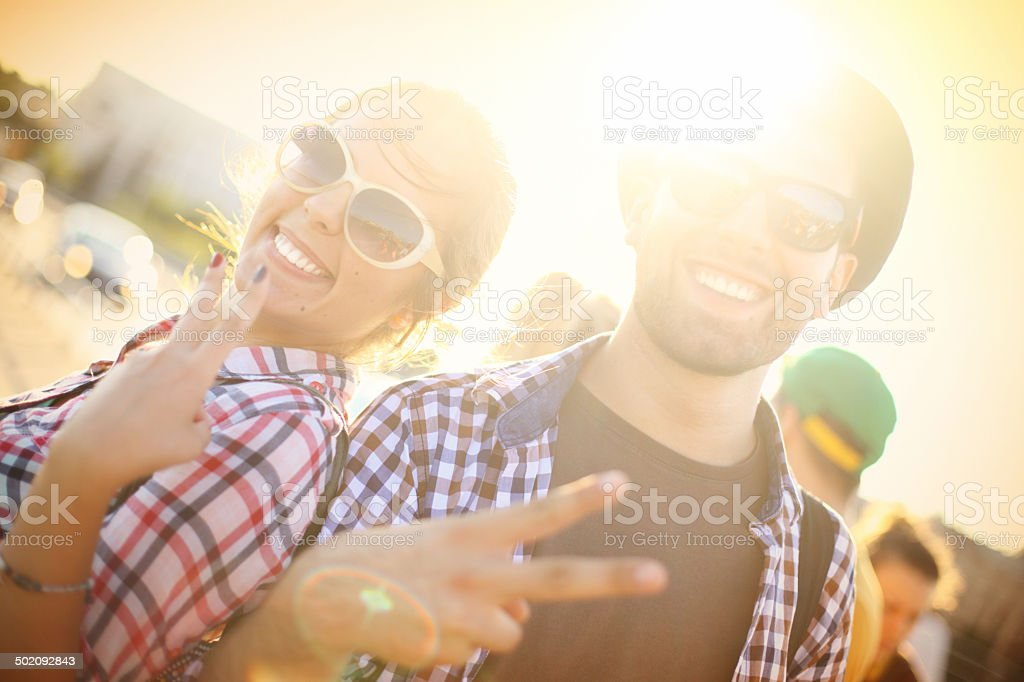 Friends showing peace sign. royalty-free stock photo
