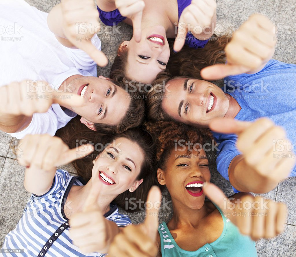 Friends showing thumbs up stock photo