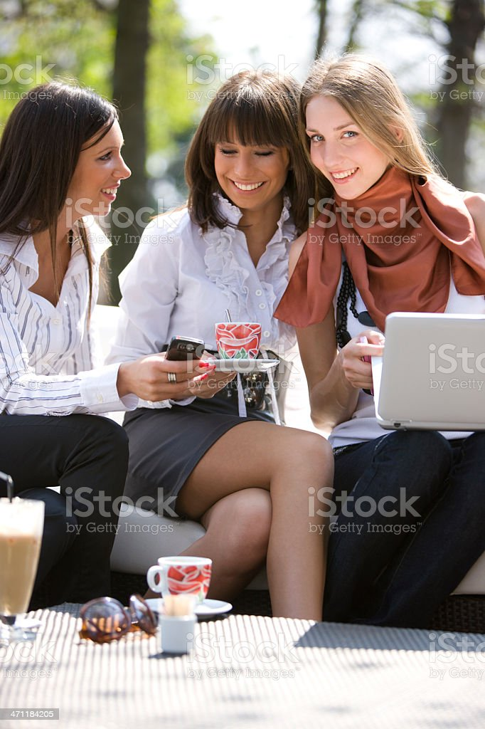 Friends sitting at cafe royalty-free stock photo