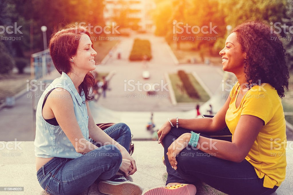 Friends sitting face to face stock photo