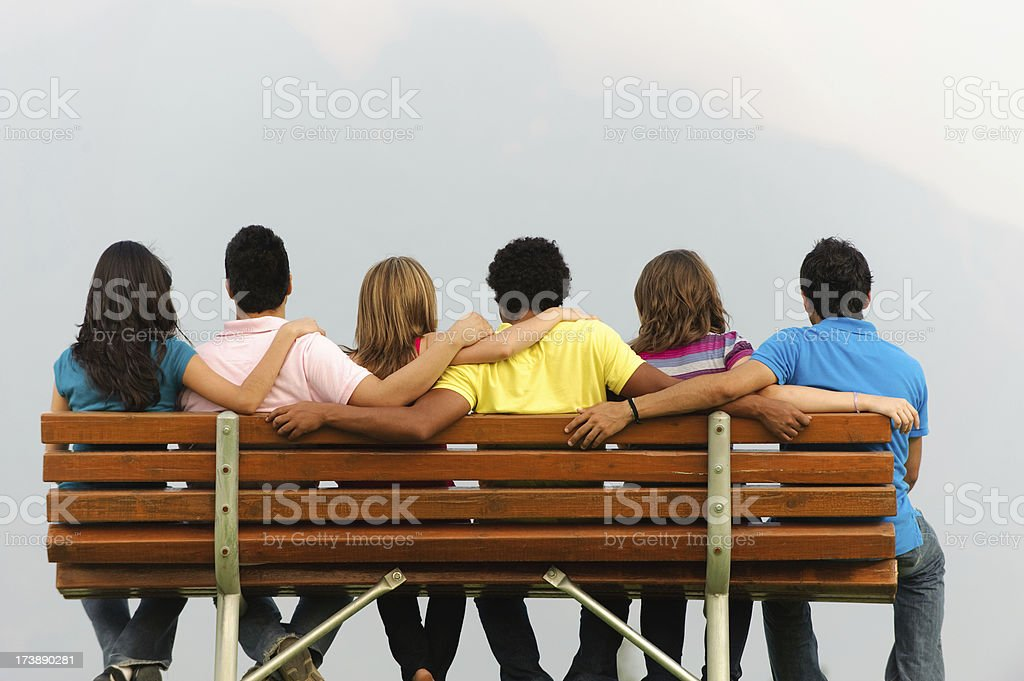 Friends sitting on a bench royalty-free stock photo