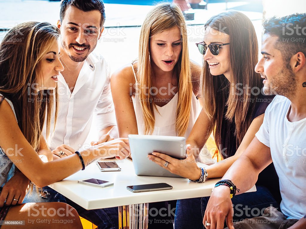 Friends Sitting Together At The Bar stock photo
