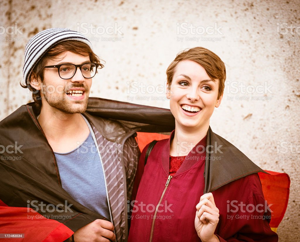 Friends smiling embracing on berlin royalty-free stock photo