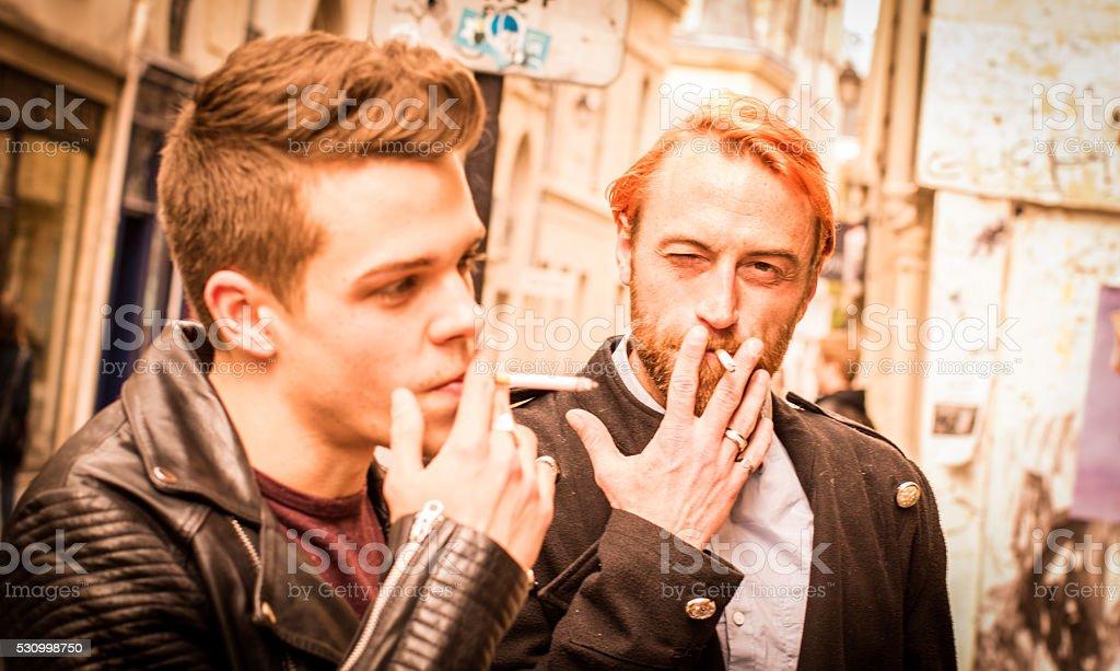 Friends Smoking alongside the streets of Paris stock photo
