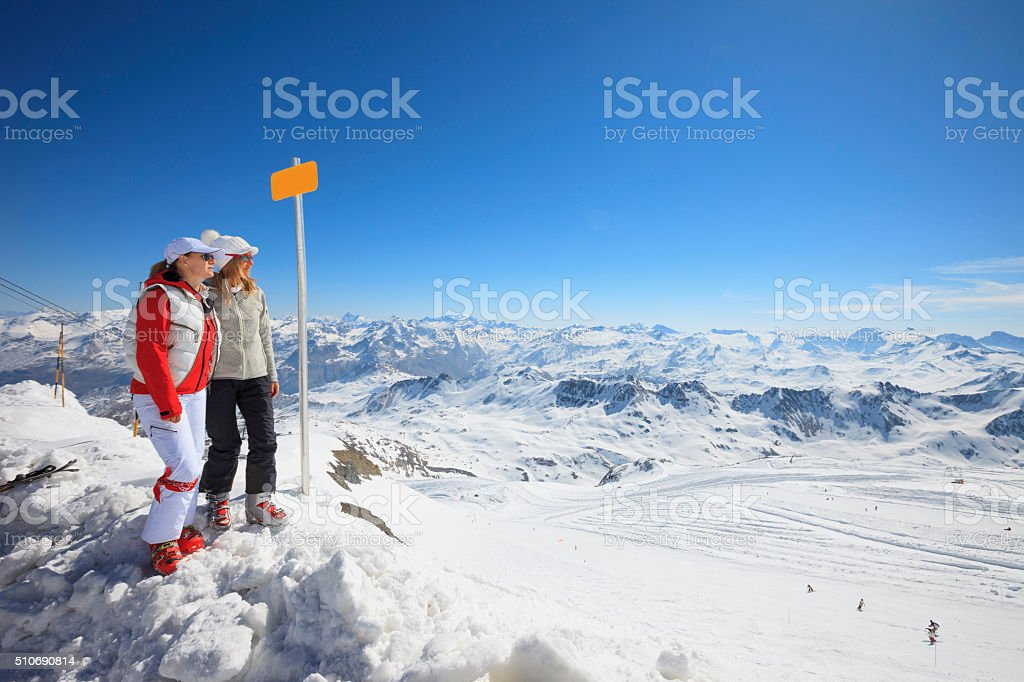 Friends Snow skier  two women at the top   Winter mountain stock photo
