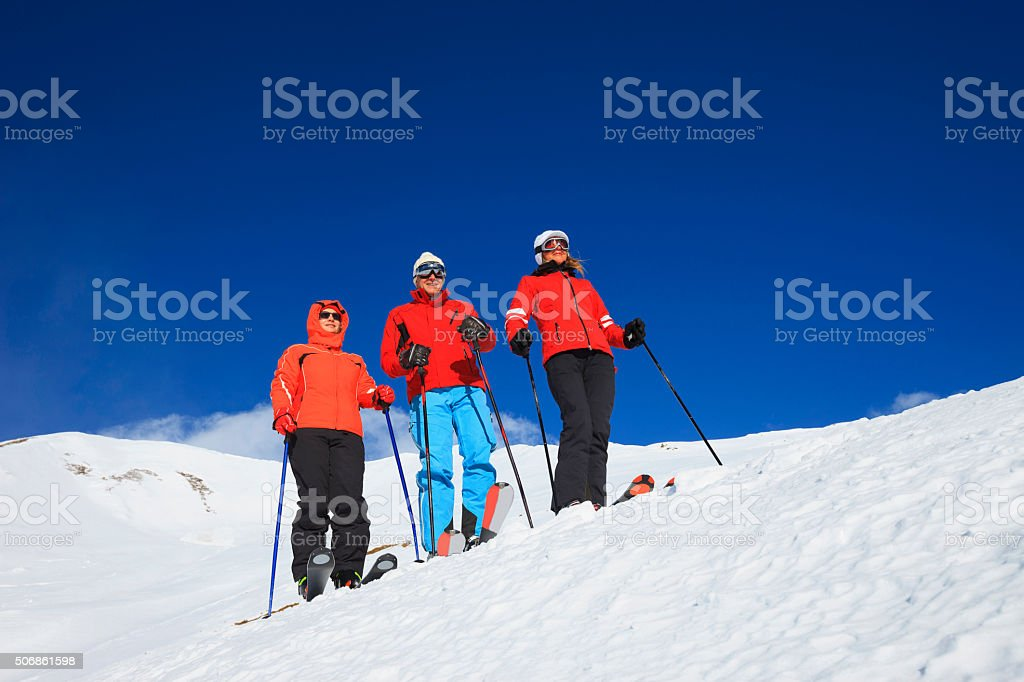 Friends snow skiers group at the top  winter Alps mountains stock photo