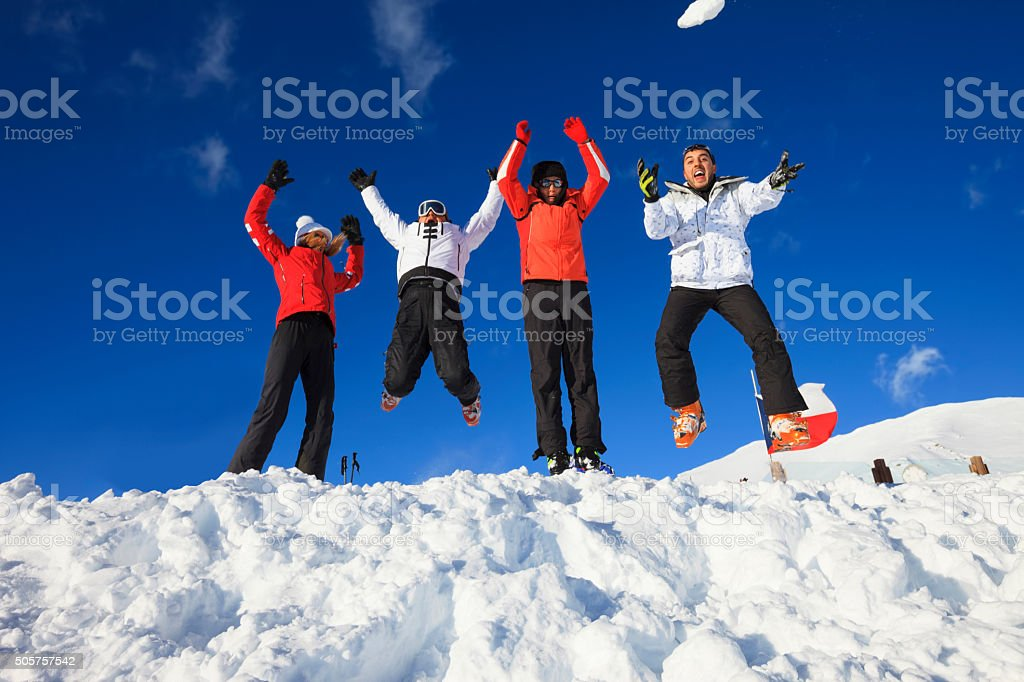 Friends snow skiers happy jumping fun  Top  winter Alps mountains stock photo