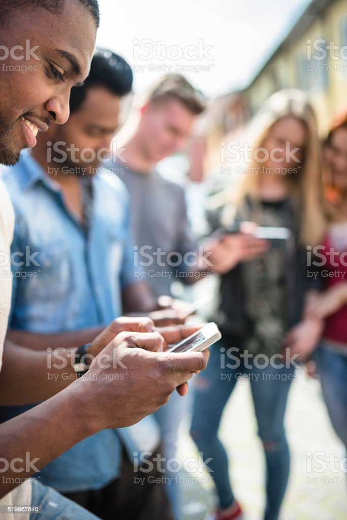 Friends social media addicted stock photo