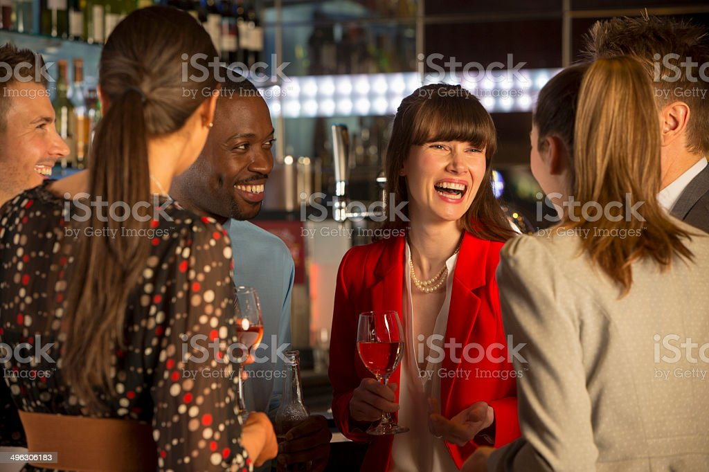 Friends Socialising At A Bar stock photo