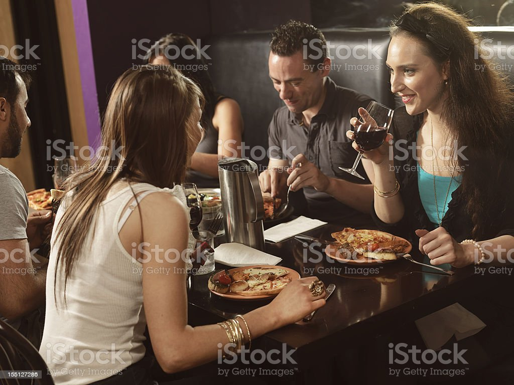 Friends socializing at a restaurant royalty-free stock photo