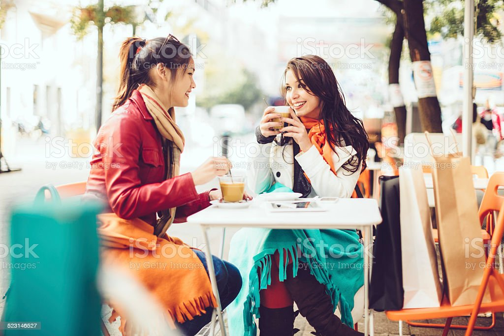Friends spending time together in a coffee shop stock photo