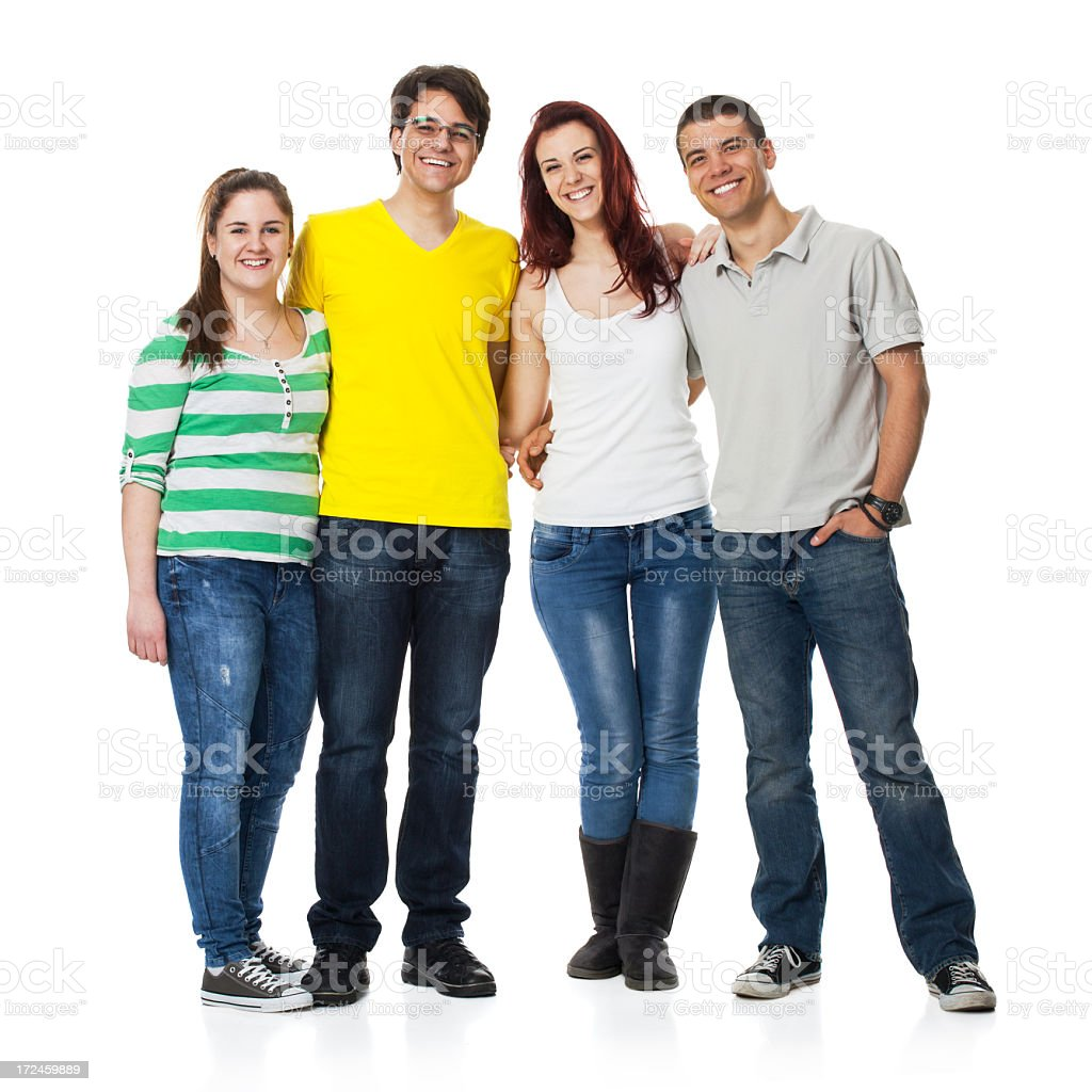Friends standing together and smiling royalty-free stock photo
