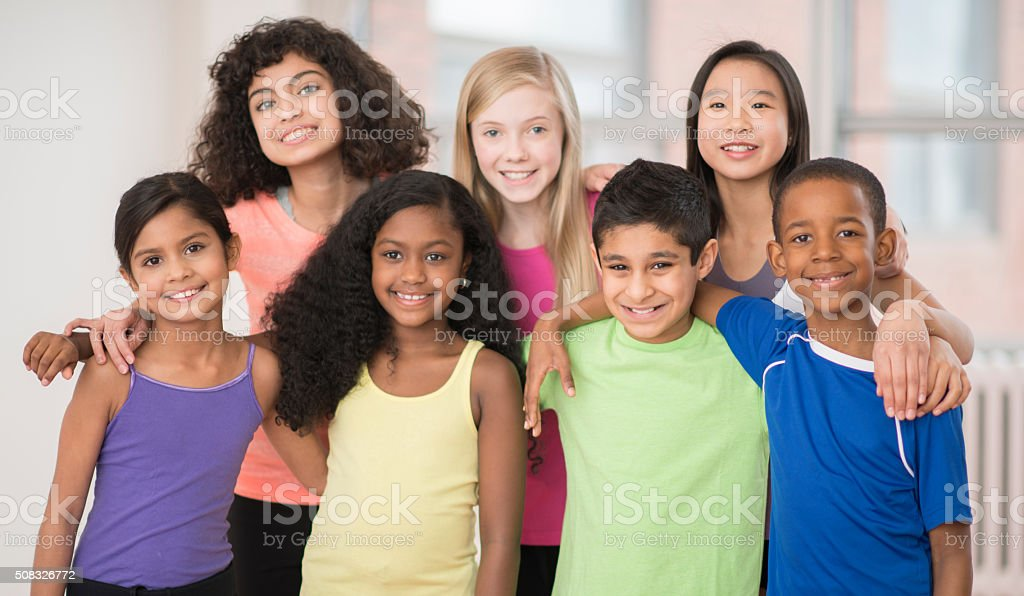 Friends Standing Together at the Gym stock photo