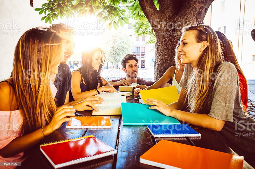 Friends studying outdoor stock photo
