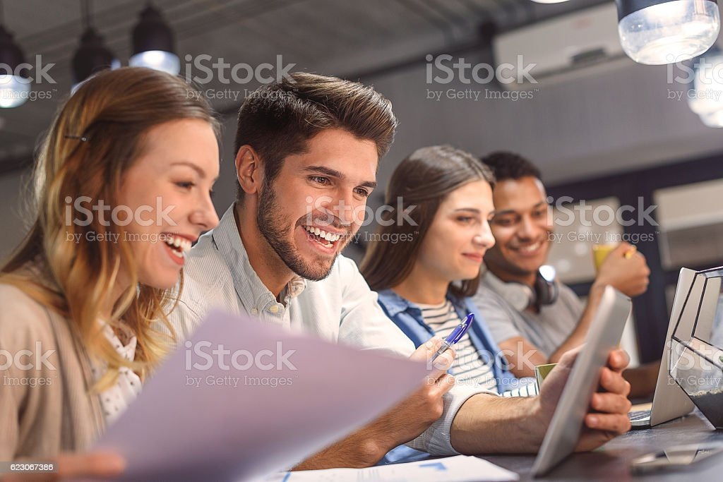 Friends studying together at coffee shop stock photo