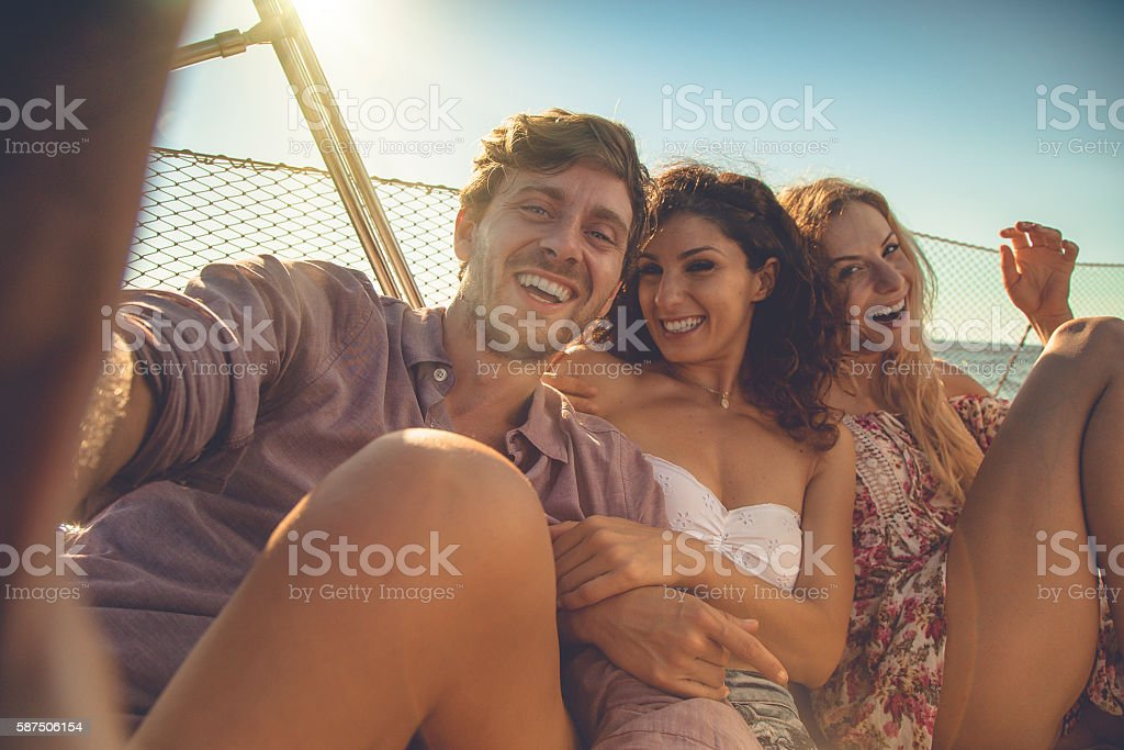 Friends summer vacation: selfie on a sailing yacht stock photo