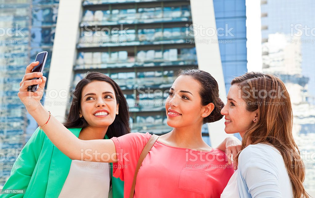 Friends surfing the web in Dubai Jumeirah Lake Towers stock photo