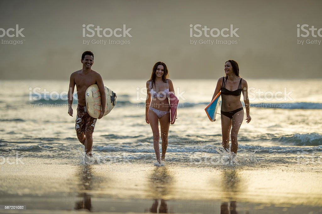 Friends Surfing Together stock photo