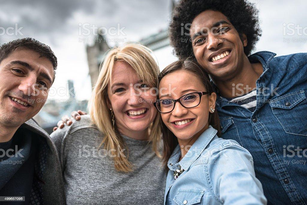 friends take a selfie in london - Tower bridge stock photo