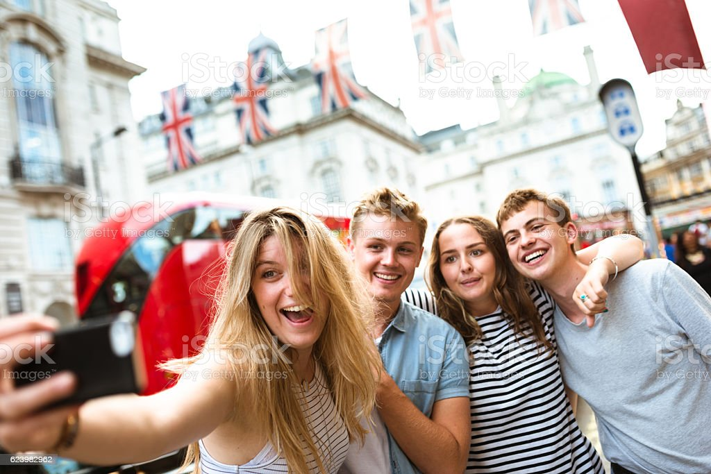 friends take a selfie in piccadilly circus stock photo