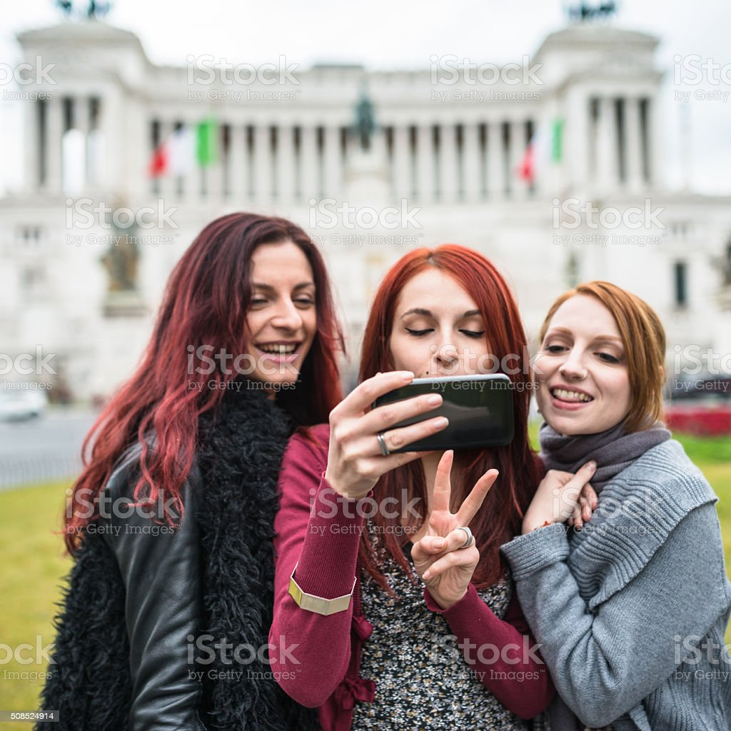 friends take a selfie in Rome - Italy stock photo