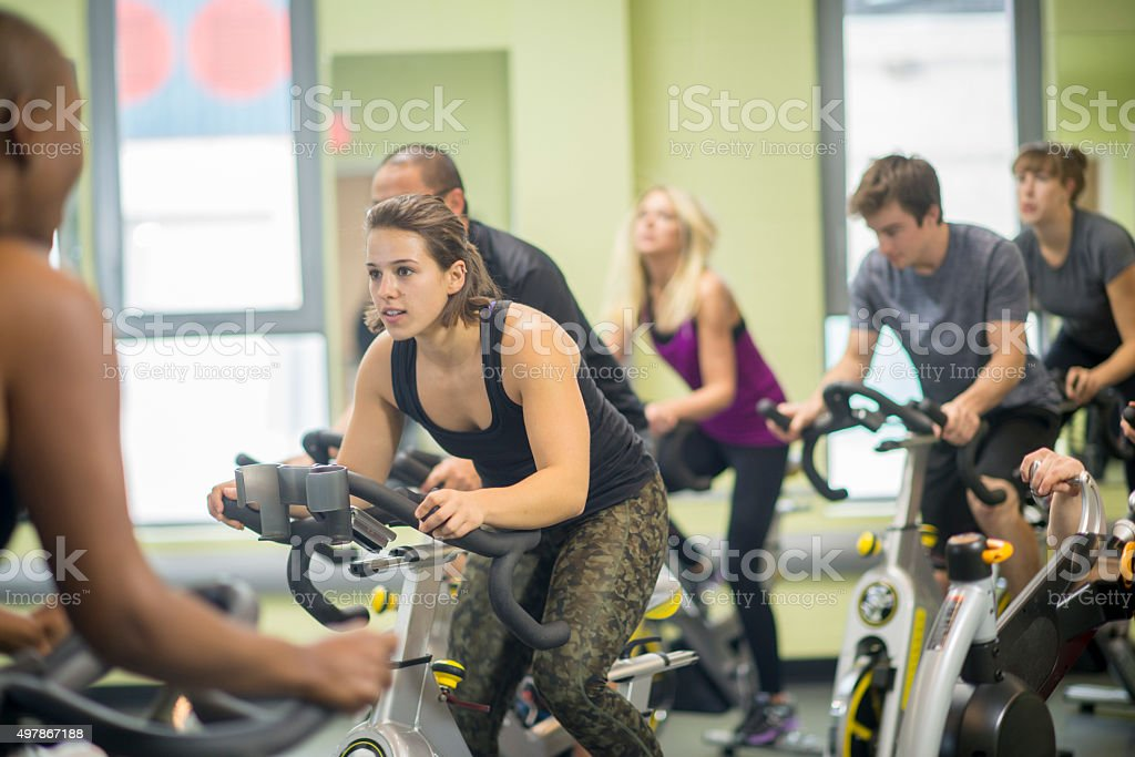 Friends Taking a Spin Class Together stock photo