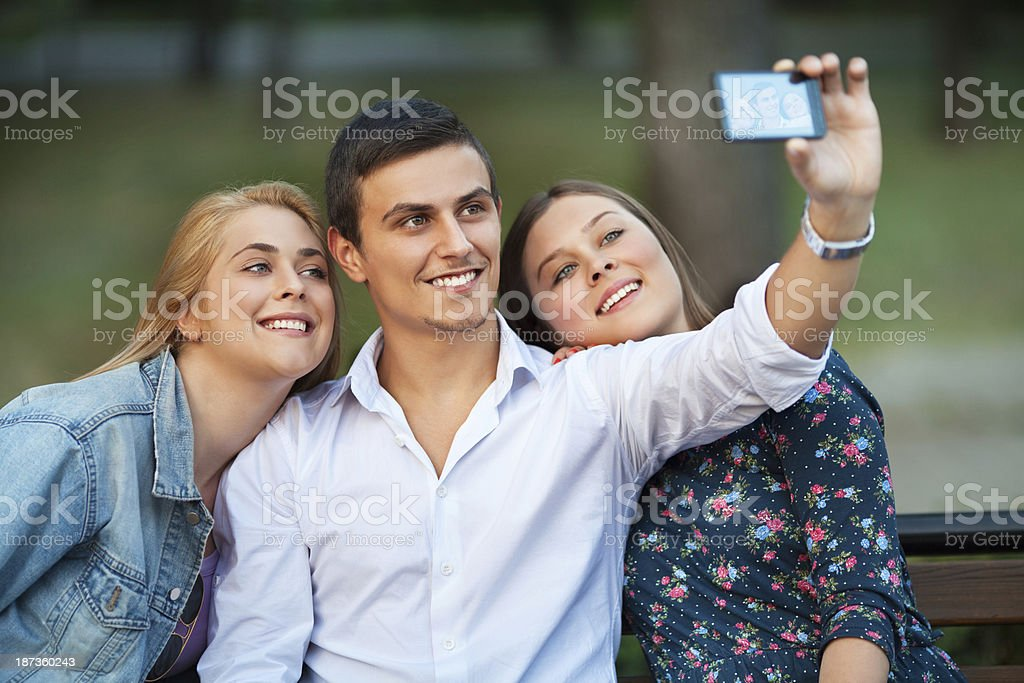 Friends taking a photo of themselves royalty-free stock photo